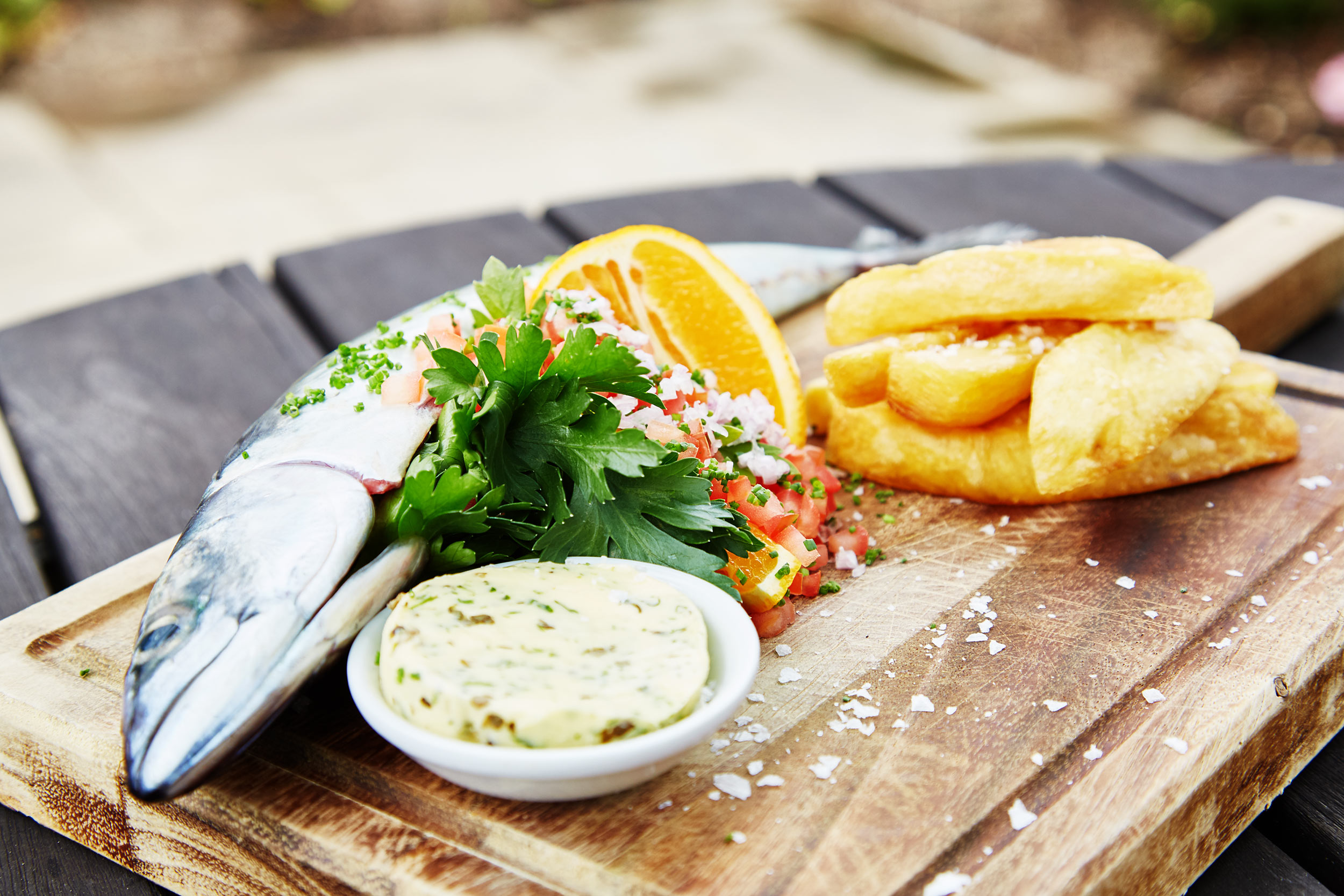 Location photographer - london - fish and chips on wooden board in pub garden.  Graphic design images.  Cape Town, South Africa.