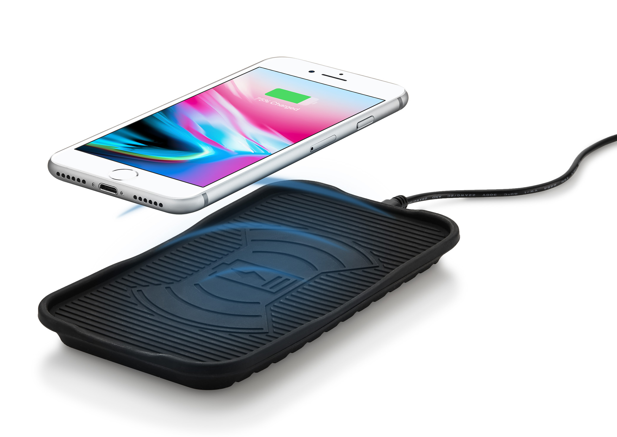Product photographer - iPhone hovering over wireless charging product