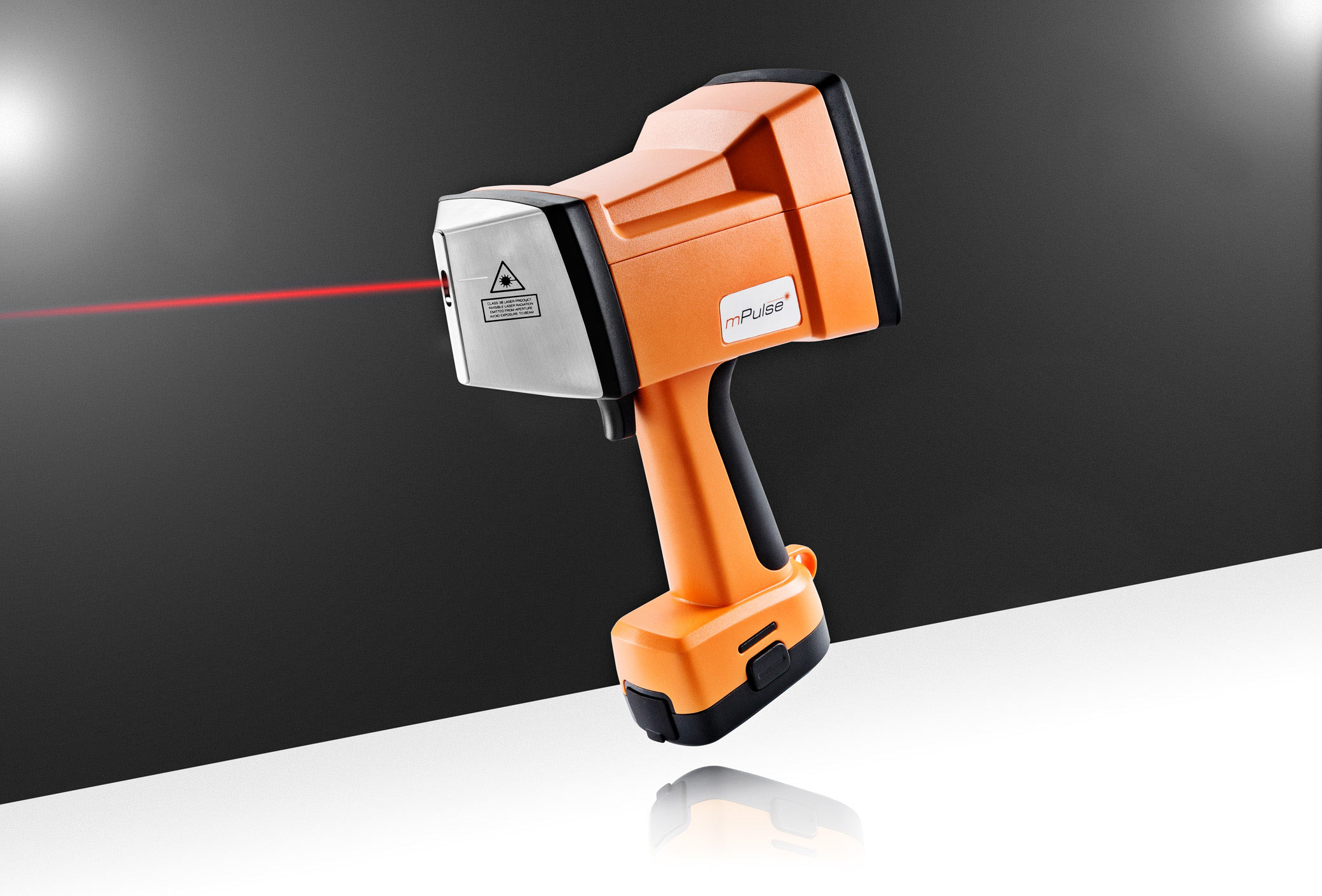 Product photography - Orange laser tool used to test for various metals.  Photographed in Sussex studio for  product development company