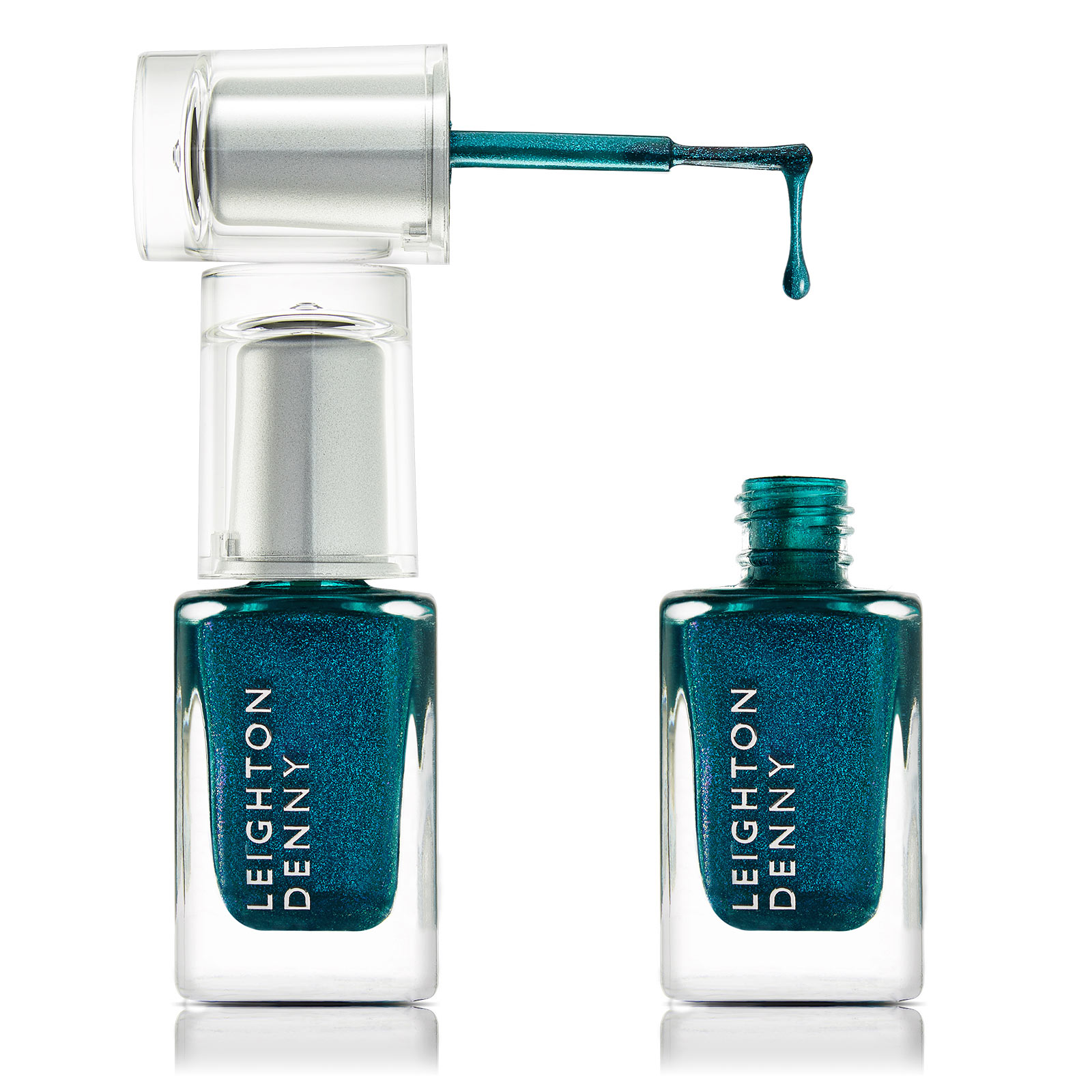 Product photography - green coloured nail varnish in bottles with brush dripping
